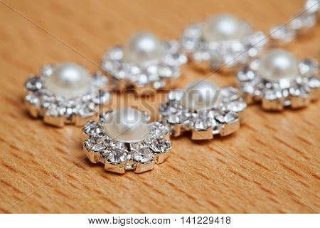 Wedding bijouterie of a bride on table. Closeup