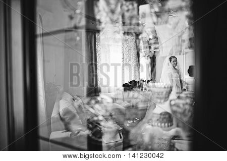 Bride Reflection In The Mirror. B&w Photo