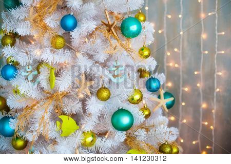 White decorative x-mas tree with colourful balls christmas concept