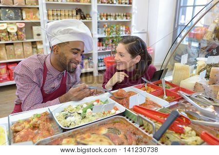 foodstore assistant helping customer