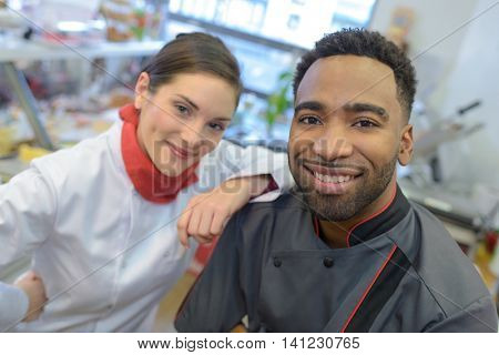 crew of professional cooks working at restaurant kitchen