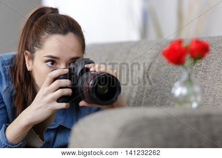 teenage girl taking photographs with a professional camera