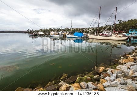 The fishing boats in the port of St Helens, Georges Bay, Tasmania, Australia. St Helens is the most important city of the northeast coast and is famous for the Bay of Fires