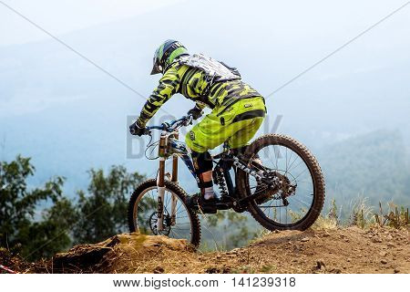 Magnitogorsk Russia - July 23 2016: man extreme athlete on bike descent from top of mountain during National championship downhill