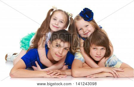 portrait of 4 people just two little girls and two boys lying on the floor-Isolated on white background