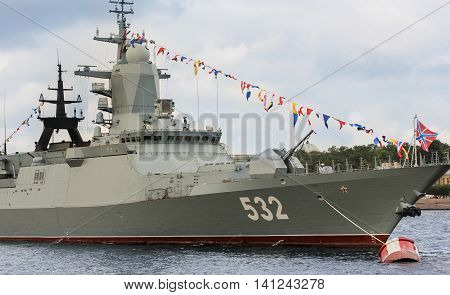 St. Petersburg, Russia - 31 July, Signal flags on the bow of the ship, 31 July, 2016. Festive parade of warships on the Neva River in St. Petersburg.