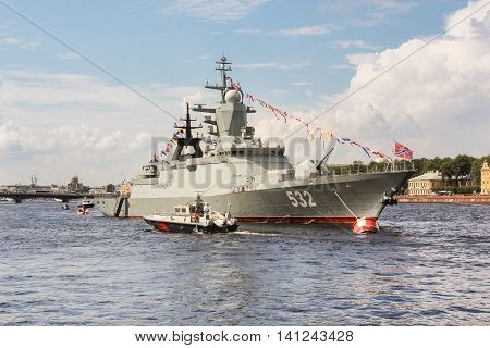 St. Petersburg, Russia - 31 July, The boat passes by ship, 31 July, 2016. Festive parade of warships on the Neva River in St. Petersburg.