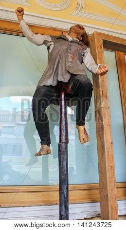 St. Petersburg, Russia - 9 April, Human figure impalement, 9 April, 2016. Wax Museum Gallery large Gostiny Dvor.