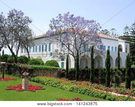 Mansion of Bahji and Jacaranda in Bahai garden in Akko Israel