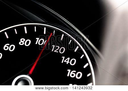 Closeup of a Speedometer in a Car