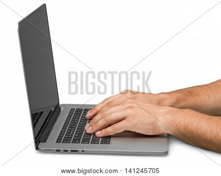 Closeup of a Man Typing on a Laptop