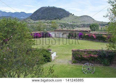 Mexican hacienda ranch plaza. Decorative traditional design and mountain in back.