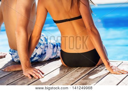 Vacation Lifestyles-Couple Relaxing in Pool and Looking at View