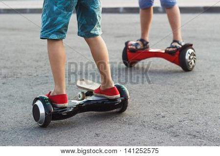 Boys Stands On The Black Gyro Scooter Outdoors