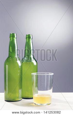 Apple Cider, Over A Grey Background.