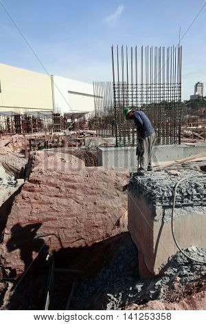 worker with stone crusher on civil construction in sao paulo brazil