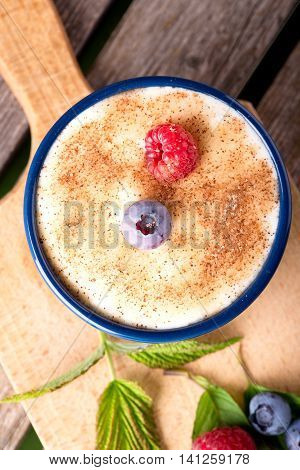 Top View On Creamy Dessert With Fresh Berries On Chopping Board