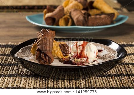 Cannoli With Ice Cream, Chocolate And Almonds