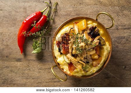 Shredded Chicken With Mashed Potatoes And Vegetables Served In The Table.