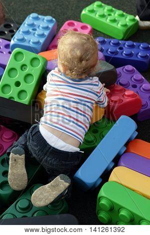 Toddler Crawling On Cubes