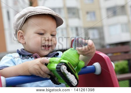 Toddler Playing With Toy Excavator