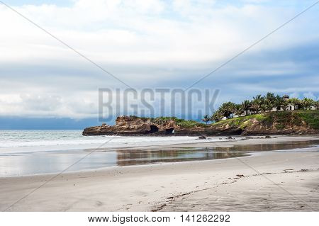 Small charming fishing village of Mompiche is located in the northern Ecuadorian Pacific coastline perfect surfing setting with thickly forested hills dropping down to a wide beach backed by palm trees
