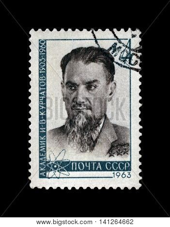 USSR - CIRCA 1963: cancelled stamp printed in the USSR shows famous soviet scientist physicist I. V. Kurchatov (1903-1960), circa 1963. vintage post stamp on black background.