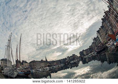 cozy touristic french Honfleur town; small european cloudy fishing village;