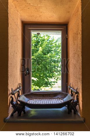 Relaxing window facing the green garden with wooden plate in front