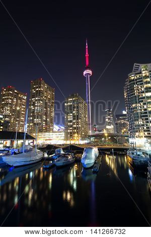 Toronto city harbor and cn tower canada; urban skyline; business center of big city; canadian coast