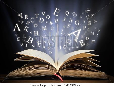 Glowing letters on book light  high quality studio shot