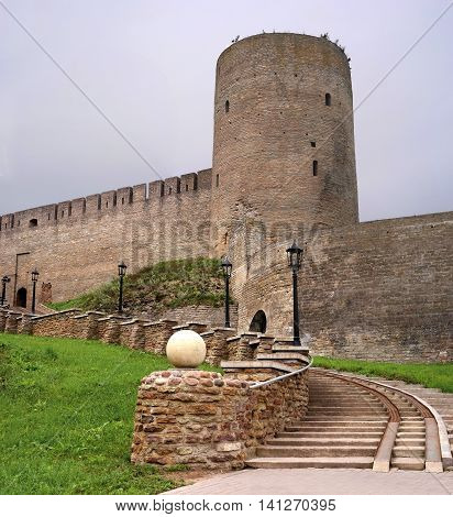 Russian medieval castle in Ivangorod. Located on the border with Estonia, not far from St. Petersburg. The photo shows the entrance to the fortress and watchtower. Photographed on a cloudy day.