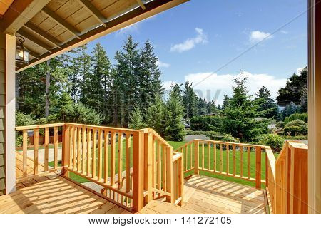 Wooden Walkout Deck With Patio Area