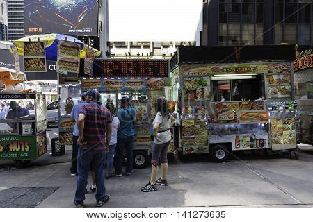 New York NY USA --August 3 2016 A line forms at one of many food carts in Times Square. Editorial Use Only.