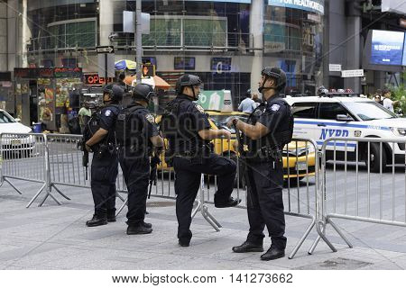 New York NY USA -- Aug 3 2016 New York City Police Officers provide security for Times Square. Editorial Use Only.