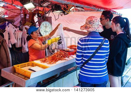 RICHMOND, CANADA - JULY 10: Visitors buying fresh shrimps at the picturesque seaside village of Steveston Fisherman's Wharf in Richmond near Vancouver July 10, 2016. The place is famous for fresh seafood and many eateries and unique shops.