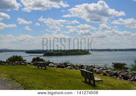 Benches facing Boston Harbor on Spectacle Island.
