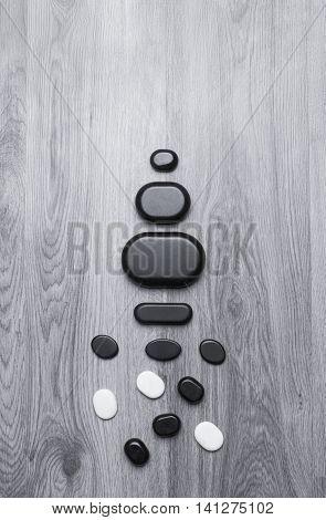 basalt spa stones on wooden background; basalt spa tools on wooden background;