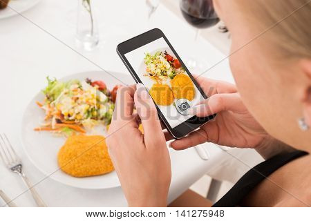 Close-up Of Woman Taking Picture Of Food With Mobile Phone
