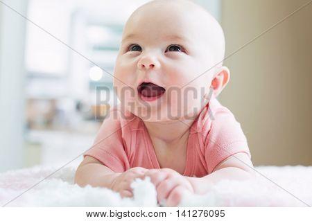 Happy Newborn Baby Girl Smiling