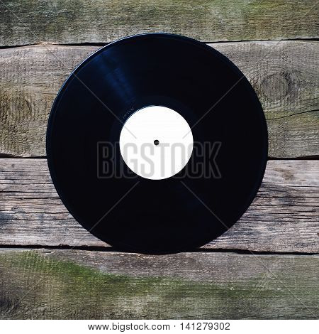 Old Vinyl Record With White Label On The Old Vintage Floor