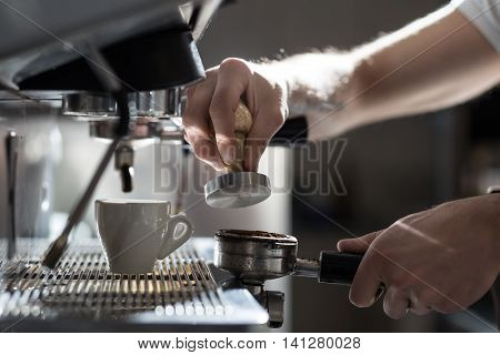 coffee making process; espresso cup and machine; bartender brewing morning espresso;