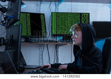 Boy Using Keyboard While Stealing Information From Multiple Computers