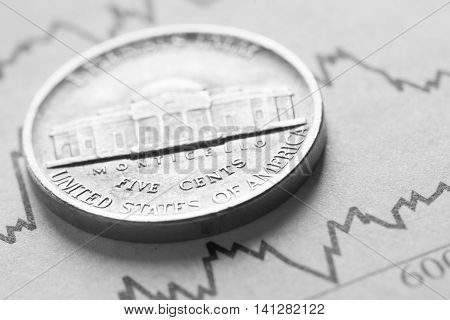 The coin five cents on graphics background. Studio shot