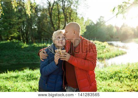 Happy Seniors Couple Embrace And Smile;