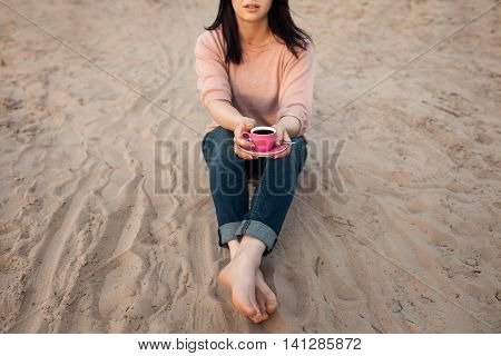 Barefoot Female On The Beach And With Cup Of Coffee;