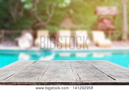 wood Table Top Background and Swimming Pool.