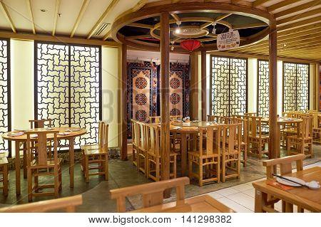SINGAPORE - CIRCA NOVEMBER, 2015: interior of a restaurant in Singapore Changi Airport. Changi Airport  is the primary civilian airport for Singapore.