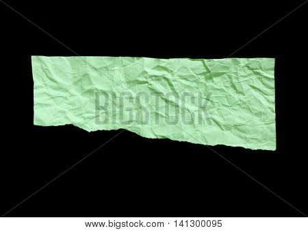 Tear green paper on black background for message