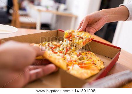 Sharing pizza at home